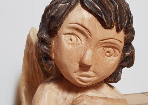 Amorino - scultura su tiglio 18x14x15 cm